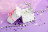 Beautiful box with wedding ring on purple background — Foto de Stock