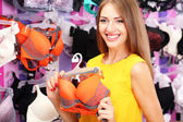 Two beautiful young woman in shop with underwear — Stock Photo