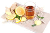 Cup of tea with ginger on napkin isolated on white — Stock Photo