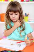 Little girl draws sitting at table close-up — Stock Photo