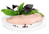 Raw chicken fillets on white plate, isolated on white — Stock Photo