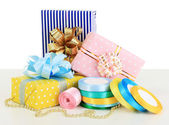 Tapes for wrapping gifts with holiday gifts isolated on white — Zdjęcie stockowe