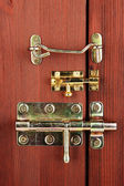 Metal bolts, latches and hooks in wooden door close-up — Stock Photo