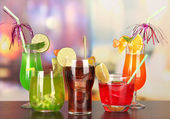 Set of different drinks on bright background — Stock Photo