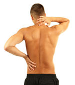 Young man with back pain, isolated on white — Stock Photo