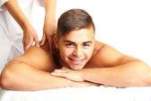 Young man having back massage close up — Stock Photo