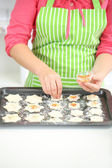Woman in kitchen during cooking Christmas biscuits, close up — Stock Photo