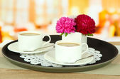 Cups of coffee on tray on table in cafe — Stock Photo