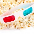 Popcorn and 3D glasses, isolated on white — Stock Photo