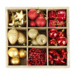 Wooden box filled with christmas decorations, isolated on white — Stock Photo