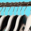 Black and white clothes hangers on color background — Stock Photo