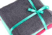 Towels tied with ribbon close-up — Stock Photo