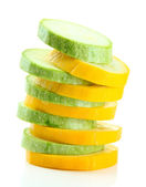 Sliced raw zucchini, isolated on white — Stock Photo