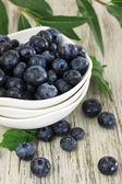Blueberries in bowls on wooden table — Stock Photo
