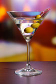 Martini with green olives on table in bar — Stock Photo