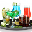 Stock Photo: Many glasses of cocktails on tray, isolated on white