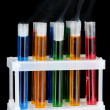Laboratory test tubes on black background — Stok fotoğraf