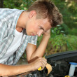 Young driver repairing car engine outdoors — Stock Photo