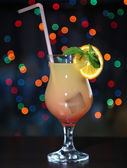 Tasty cocktail on bright background — Stock Photo