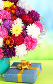Beautiful bouquet of chrysanthemums on table on bright background — 图库照片