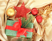 Beautiful bright gift and christmas decor, on silk cloth — Photo