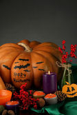 Composition for Halloween with pumpkins and candles on dark background — Stock Photo