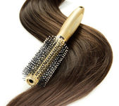 Shiny brown hair with comb isolated on white — Stock Photo