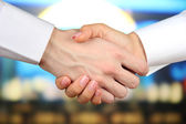 Business handshake on bright background — Stok fotoğraf