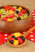 Oatmeal with fruits on table close-up — Stok fotoğraf