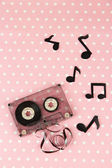 Old cassette on pink background — Stock Photo