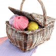 Multicolored clews in wicker basket with napkins closeup — Stock Photo #32340411