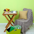 Stock Photo: Magazines and folders in green box on table in room