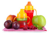 Fruits and baby bottles with compote on napkin isolated on white — Stock Photo