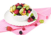 Fruit salad in bowl, isolated on white — Stock Photo