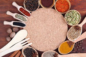 Various spices and herbs with empty board — Stok fotoğraf