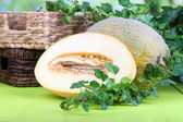 Ripe melons on wooden table on natural background — Stock Photo