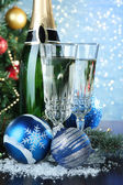 Composition with Christmas decorations and two champagne glasses, on bright background — Стоковое фото