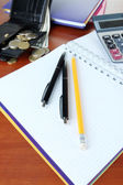 Office supplies with wallet and money close up — Stock Photo