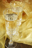 Composition with two champagne glasses, on bright background — Stock Photo