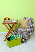 Magazines and folders in green box on table in room — Stock Photo