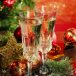 Composition with Christmas decorations and two champagne glasses, on bright background — Stock Photo #32351523