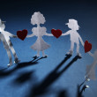 Paper people in social network concept on dark background — Stock Photo #32505055
