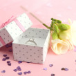 Stock Photo: Beautiful box with wedding ring and flower on pink background