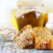 Honey and milk spa with oils and honey on wooden table close-up — Stock Photo