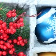 Stock Photo: Beautiful packaged Christmas ball, close up