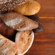 Much bread on wooden board — Stock Photo #32503661