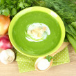 Tasty spinach soup, on wooden table — Stock Photo #32505203