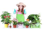 Jardineiro menina bonita com flores isoladas em branco — Foto Stock