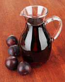 Delicious plum juice on table close-up — Stock Photo