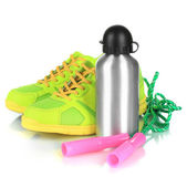 Sports bottle,sneakers and skipping rope isolated on white — Stock Photo